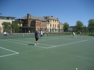 Tennis courts in Bournemouth at Shelley Park, Bournemouth. People playing tennis in Dorset.